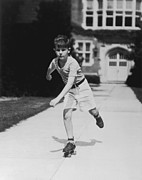 White T-shirt Photos - Rollerskating Boy by Fpg