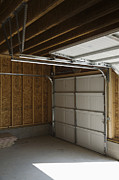 Frame House Photos - Rolling Garage Doors by Roberto Westbrook