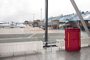 Concourse Prints - Rolling Luggage in an Airport Concourse Print by Jaak Nilson