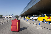 Airline Industry Prints - Rolling Luggage Outside an Airport Terminal Print by Jaak Nilson