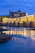 Travel Sightseeing Prints - Roman Bridge on Guadalquivir River at Dawn Print by Artur Bogacki