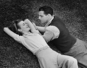 30-39 Years Framed Prints - Romantic Couple Lying On Grass, (b&w), Elevated View Framed Print by George Marks