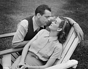 Lawn Chair Posters - Romantic Couple Relaxing On Deckchair, (b&w) Poster by George Marks