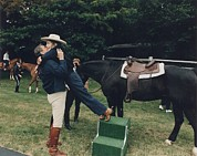 Equestrians Framed Prints - Ronald Reagan Affectionately Assists Framed Print by Everett