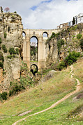 Arched Bridge Photos - Ronda Bridge in Andalucia by Artur Bogacki