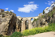 Arched Bridge Photos - Ronda Bridge in Spain by Artur Bogacki