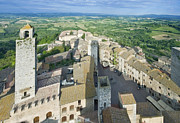 Rooftops Of San Gimignano Print by Rob Tilley