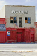 Red Buildings Posters - Rooms and a beer sign Poster by James Steele