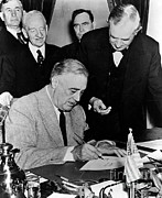 44th President Prints - Roosevelt Signing Declaration Of War Print by Photo Researchers
