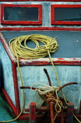 Ropes Prints - Ropes and rusty anchors on a boat deck Print by Sami Sarkis