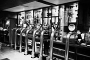 Beer Photos - row of beer stout and ale pumps in a pub in Scotland UK by Joe Fox