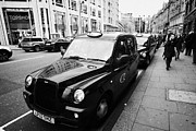 London Cab Posters - Row Of Black London Cabs Taxis For Hire On Knightsbridge Shopping Street In Central London  Poster by Joe Fox