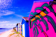 Beach Huts Posters - Row of colourful beach huts Poster by Marianne Ellis