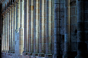 Architectural Feature Photos - Row of columns forming the wall of the monastery at Mont Saint-Michel by Sami Sarkis