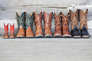 Log Cabin Prints - Row Of Cowboy Boot On Porch Of Log Cabin Print by Vstock LLC