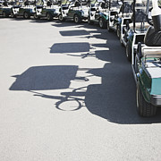 Casting A Shadow Framed Prints - Row of Empty Golf Carts Framed Print by Jetta Productions, Inc