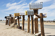 Mail Box Framed Prints - Row Of Mailboxes Along Desert Road Framed Print by Paul Edmondson