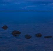Stepping Stones Prints - Row of stones in water at midnight Print by Kathleen Smith