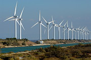 Sami Sarkis Photo Metal Prints - Row of wind turbines along canal Metal Print by Sami Sarkis
