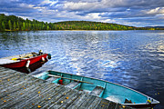 Canada Photos - Rowboats on lake at dusk by Elena Elisseeva