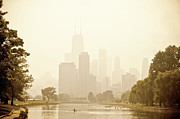 Nature Center Pond Prints - Rower in Mist with downtown Chicago in the background Print by Andria Patino