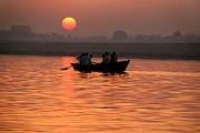 Ganga Photos - Rowing Boat on the Ganges at Sunrise by Serena Bowles