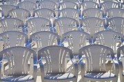 Outdoor Chair Posters - Rows of empty white plastic chairs Poster by Sami Sarkis