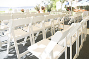 Empty Chairs Prints - Rows of White Folding Chairs Print by Ned Frisk