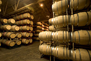 Winemaking Posters - Rows Of Wine Barrels Stacked Poster by Phil Schermeister