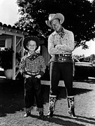 Cowboy Hands Prints - Roy Dusty Rogers Jr., And His Father Print by Everett