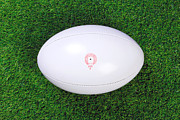 Rugby Photos - Rugby ball on grass by Richard Thomas