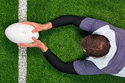 Birdseye Photo Metal Prints - Rugby player scoring a try with both hands. Metal Print by Richard Thomas