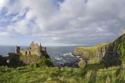 Antrim Photos - Ruins Of 13th Century Medieval Dunluce by Rich Reid