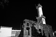 Faro Photos - ruins of san francisco convent and lighthouse Barrio Historico Colonia Del Sacramento Uruguay by Joe Fox