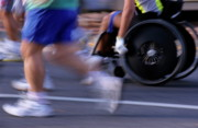 Road Running Posters - Runners and disabled people in wheelchairs racing together Poster by Sami Sarkis