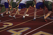 Athletes Posters - Runners Lined Up On A Track Ready Poster by Raymond Gehman