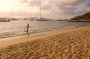 British Virgin Islands Prints - Running Along The Beach At Sunset Print by Michael S. Lewis