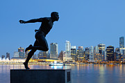 Morning Race Prints - Running Sculpture With a Downtown Background Print by Bryan Mullennix