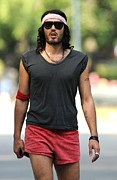 Best Of Red Carpet Prints - Russell Brand On Location For Filming Print by Everett