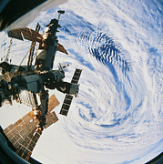 Manned Space Flight Art - Russian Space Station Mir Over A Storm On Earth by Nasa
