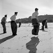 Young Men Prints - Sack Race Print by Haywood Magee