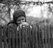 Insecurity Framed Prints - Sad peasant at the fence Framed Print by Emanuel Tanjala