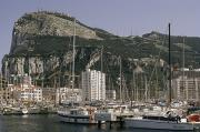 Sailboats Docked Posters - Sailboats Moored In Gibraltar Bay Poster by Lynn Abercrombie