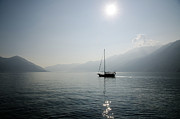 Lens Prints - Sailing Boat In Alpine Lake Print by Mats Silvan