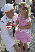 Kneeling Prints - Sailor Greets His Daughter Print by Stocktrek Images
