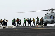 Sailors And Marines Load Supplies Onto Print by Stocktrek Images
