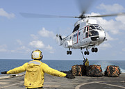 Helicopter Art - Sailors Attempt To Attach A Cargo by Stocktrek Images