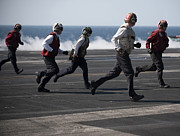 Sailors Clear The Landing Area Print by Stocktrek Images