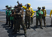 Sailors Fight A Simulated Fire Drill Print by Stocktrek Images