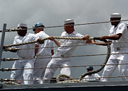 Shipmates Posters - Sailors Heave Around On A Mooring Line Poster by Stocktrek Images